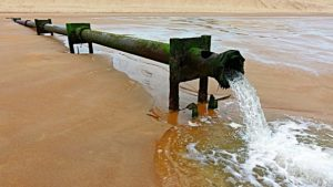 Sewer Pipe Discharging into the Ocean