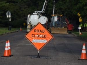 Road closed sign septic tank installation