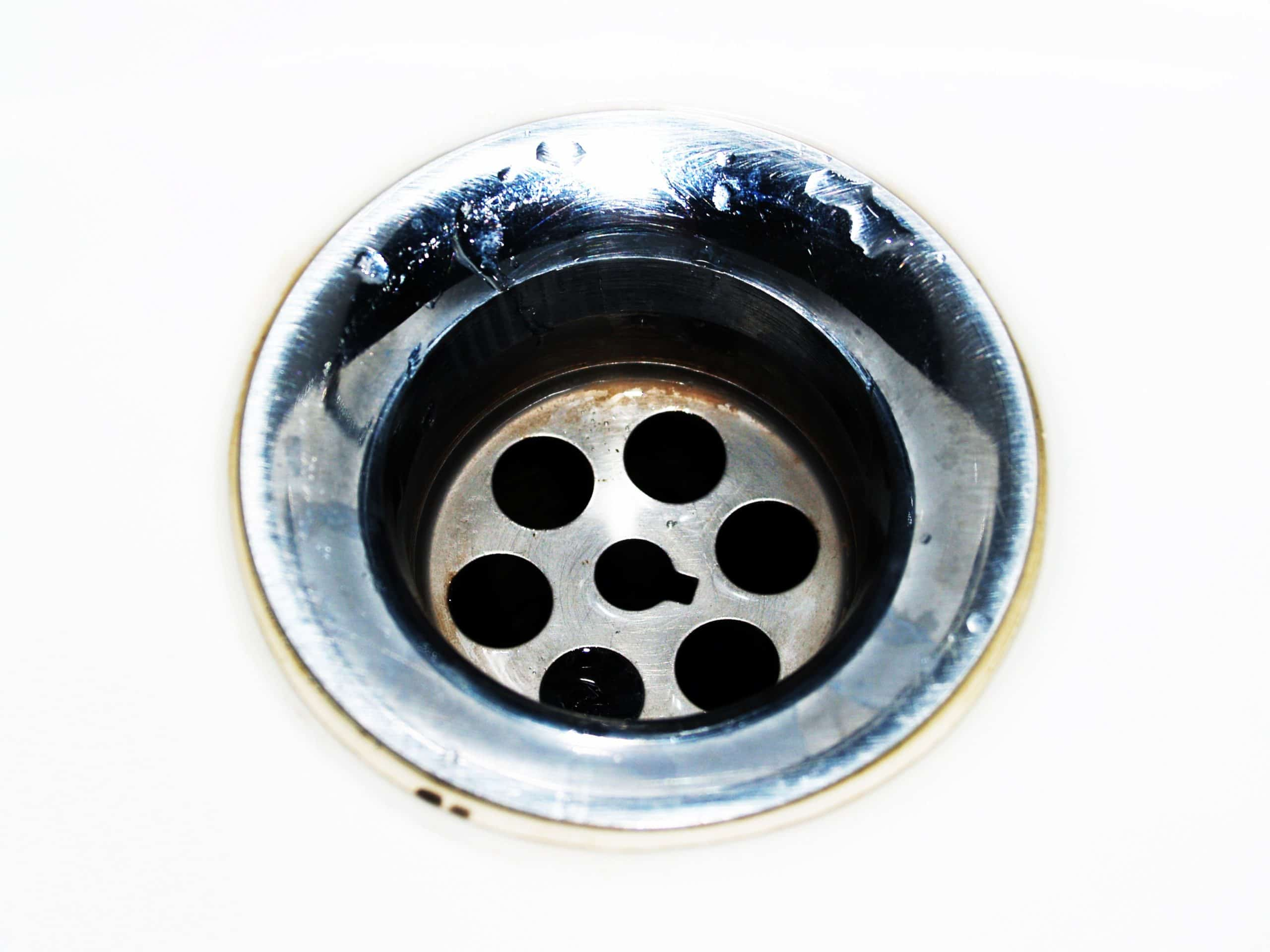 How do I fix the problem of a drain smell in my house?