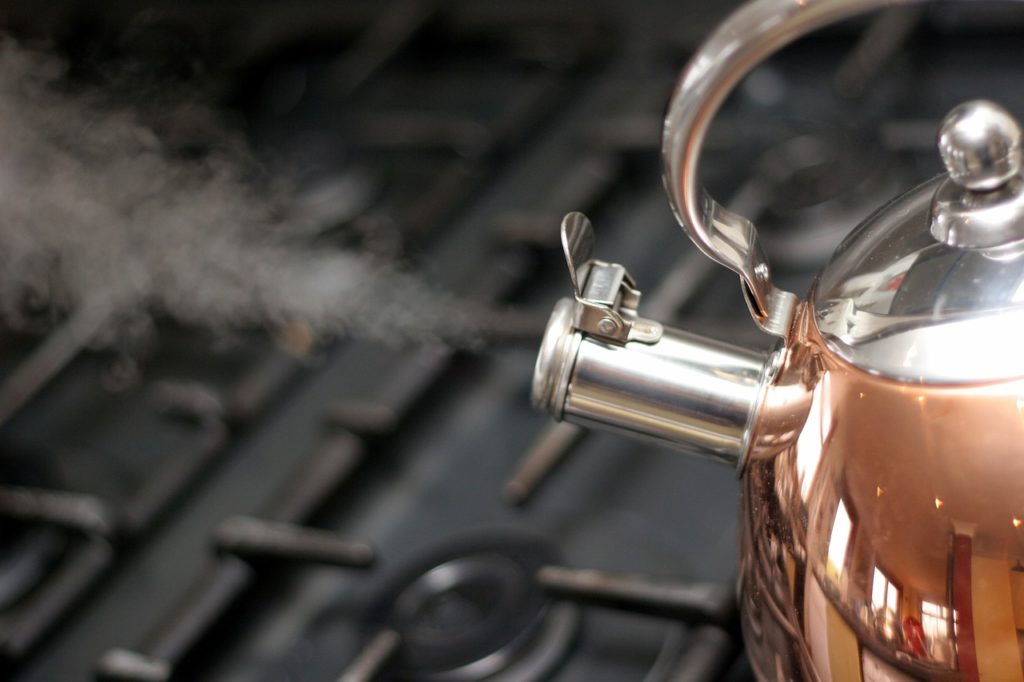 A copper kettle blowing steam