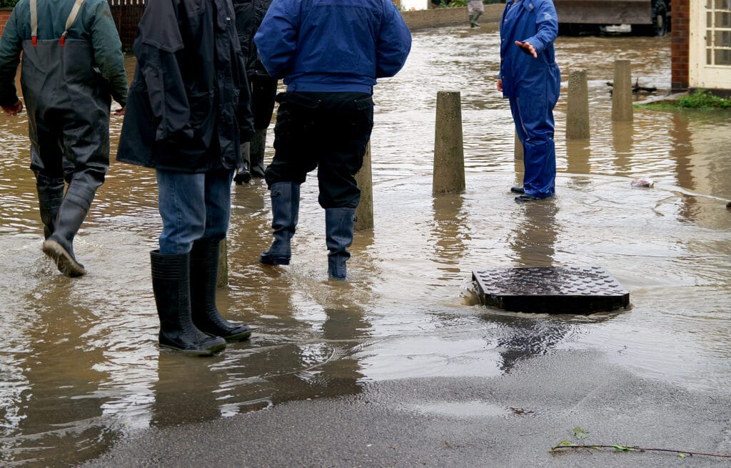 an overflowing drain in need of emergency unblocking